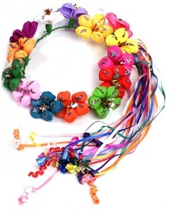 Call them what you will...Head Wreath, Flower Crown, Halo, or even go all out and call it a Corona de Flores...Every girl wants to wear one during Fiesta.