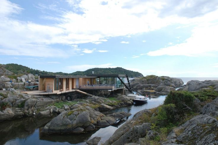 Exterior of building with boat - Nature-inspired home Norway