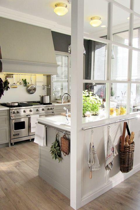 monochromatic kitchen // light wood floors + shades of gray + window panes + hanging storage