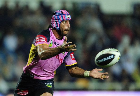 Johnathan Thurston of the Cowboys passes the ball during the round 10 NRL match between the North Queensland Cowboys and the Sydney Roosters at 1300SMILES Stadium on May 18, 2013 in Townsville, Australia.