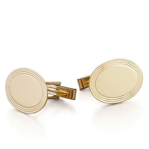 Crafted in solid 14k gold with a high polished finish, these cufflinks are of a vintage design and feature a flat (1mm thick) oval face framed with etched concentric circles which can be... More Details