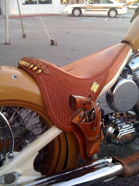 Bike seat made like a saddle, with gun holster.