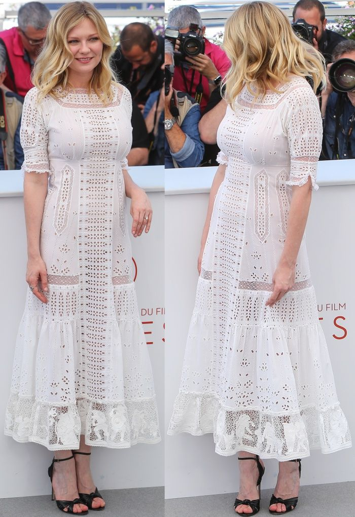 """Kirsten Dunst wearing a white Loewe spring 2017 dress and Gucci ankle-strap sandals at """"The Beguiled"""" photocall during the 70th annual Cannes Film Festival"""