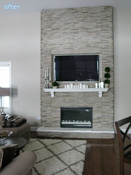 This fireplace is simply panels of stone veneer placed over a wooden frame that her husband built. The firebox is an electric insert. The whole thing took two days! Doesn't it look amazing? See more from Jaclyn at Love and Bellinis. White and Gray Fireplace Makeovers | betterafter.net