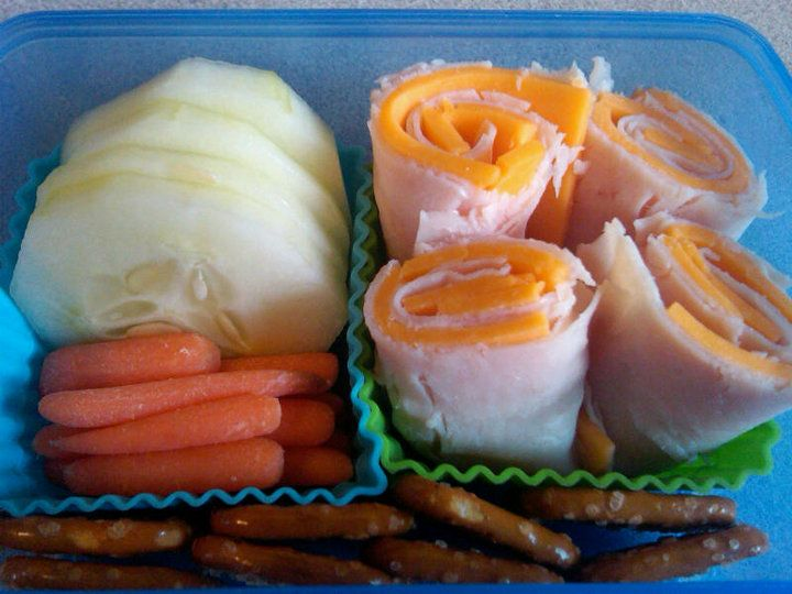 Turkey and cheese roll-ups (no tortilla), cucumbers & pretzels -- cute and easy healthy lunch