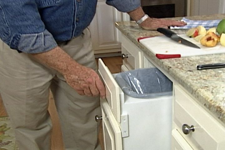 convert the under counter space behind a single kitchen cabinet door and drawer for a hidden pull out trash bin crafts diy projects pinterest trash - Kitchen Cabinets Doors And Drawers