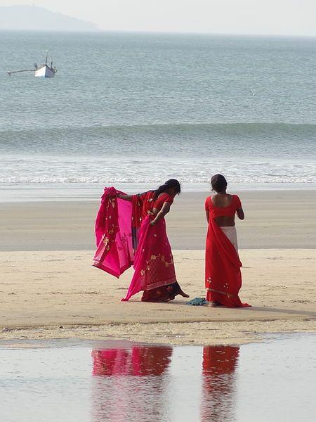 Pink saris on the beach