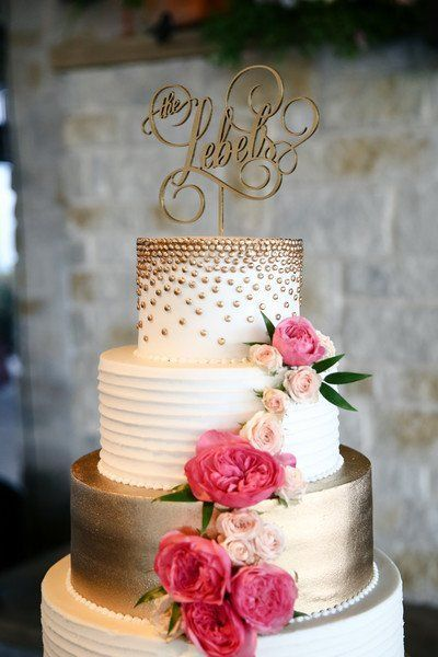 classic gold wedding cake idea with pink flower and gold cake