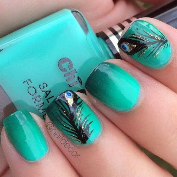 Sea green themed feather nail art design. Make your nails stand out by using sea green as the background and using black polish as silhouette figures of the feathers.