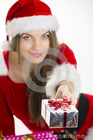 Beautiful Santa girl giving you silver gift box over white background. Selective focus on gift box. Download Christmas Girl Offering Gift Stock Photos for free or as low as 0.69 lei. New users enjoy 60% OFF. 19,941,285 high-resolution stock photos and vector illustrations. Image: 28128113