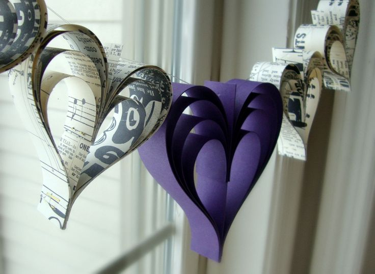 Heart garland banner Eggplant love paperie a garland of hand cut hearts. $18.00, via Etsy.
