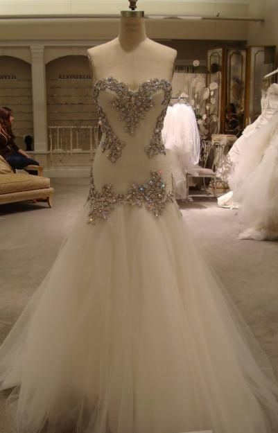 Love this panina dress except the beading along the middle. They look silly just a couple triangles in the middle of the dress