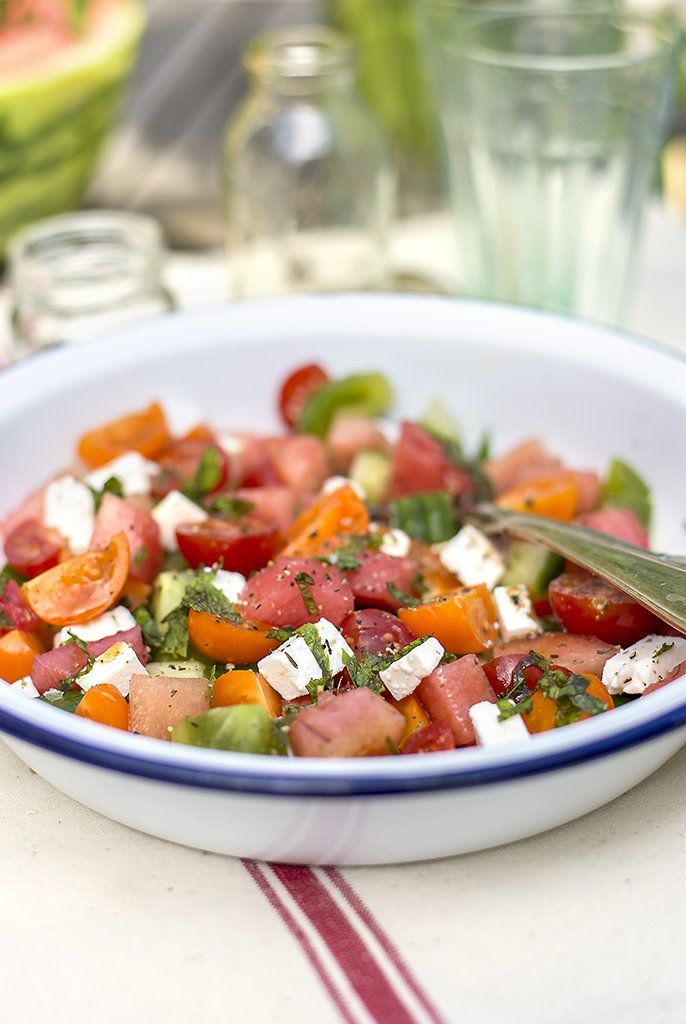 Toss up a bowl full of Summer with this watermelon salad, complete with ripe tomatoes, cucumber, feta, and ...