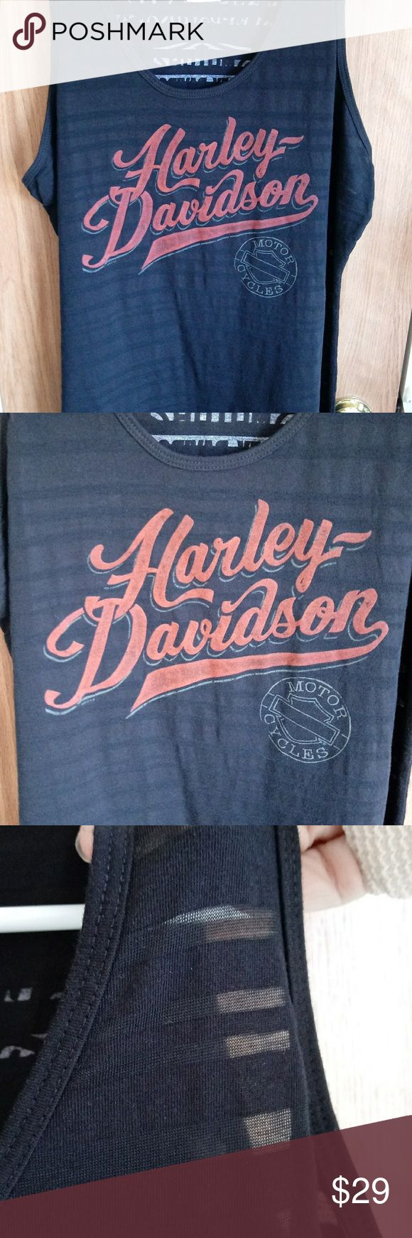 "Sheer Stripe Harley Tank Top Ghost striped Harley tank with front graphic and dealership name on back. 75% polyester 25% cotton Made in the USA 21"" across front Never worn Harley-Davidson Tops Tank Tops"