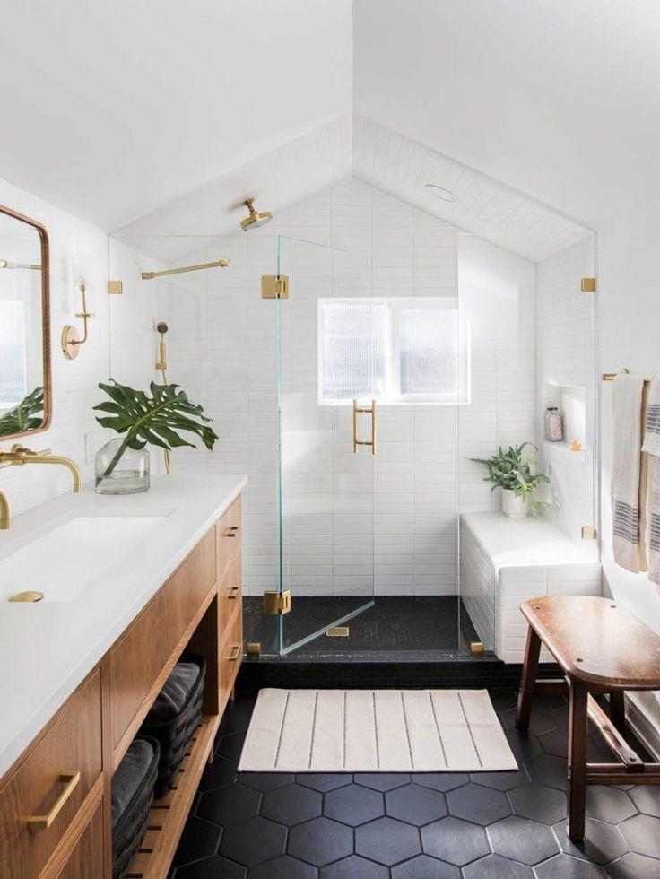 In This Modern Master Bathroom Black Hexagonal Tiles Cover The Floor While A Glass S Modern Master Bathroom Beautiful Bathroom Decor Bathroom Interior Design
