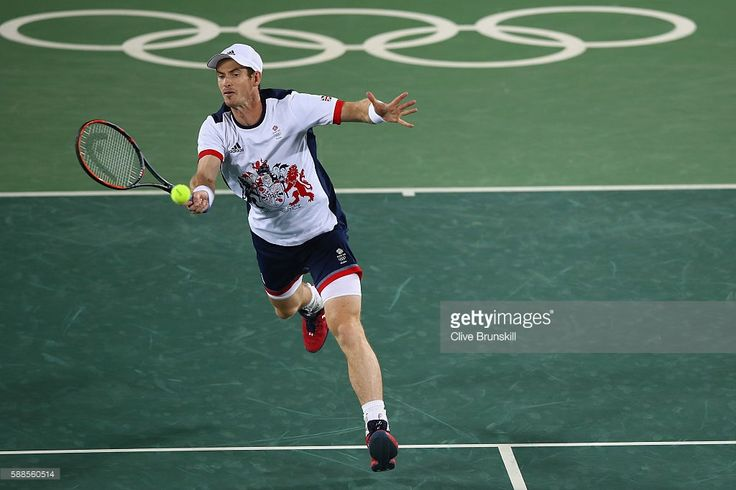Andy Murray of Great Britain plays a forehand during the mixed doubles first round match against Carla Suarez Navarro of Spain and David Ferrer of Spain on Day 6 of the 2016 Rio Olympics at the Olympic Tennis Centre on August 11, 2016 in Rio de Janeiro, Brazil.