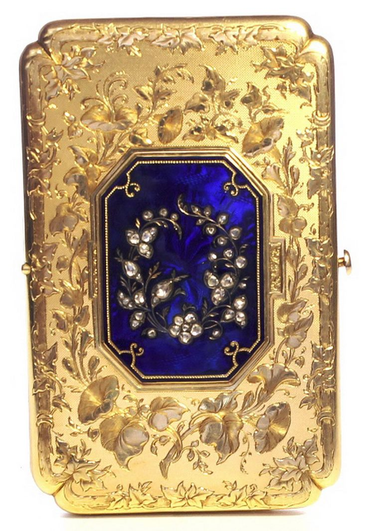 A Gold and Enamel Aide de memoire The Diamond and enamel centre opening to reveal a  secret watch  the central body opening to reveal writing slip and pencil Geneva C 1840 B.
