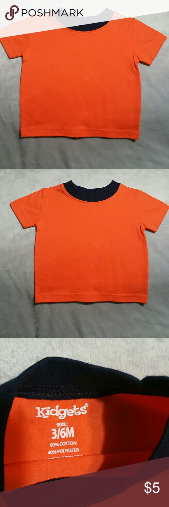 Orange T-shirt Plain Orange shirt sleeve T-shirt with Navy Blue around the collar . This item is NEW without the tags . Size 3/6 months. Kidgets Shirts & Tops Tees - Short Sleeve