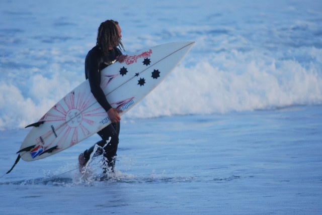 Cool Surfer with Dreadlocks on Beach in Newquay.