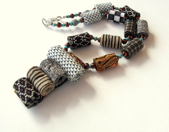 African tribes inspired artistic fiber necklace in by Gilgulim, $56.00.  Make some fabric beads to make one of these.