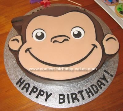 Curious George Cake: I made this Curious George cake using a round 28cm (11 inch) cake pan, and a basic dense chocolate cake batter. I printed out the picture of George (drawn
