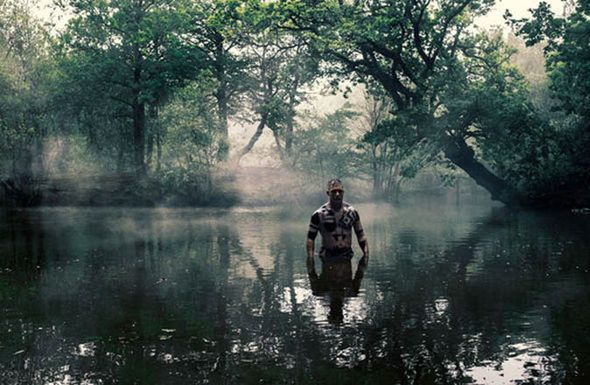 Taboo actor Tom Hardy emerging from a lake in his series, love this show!