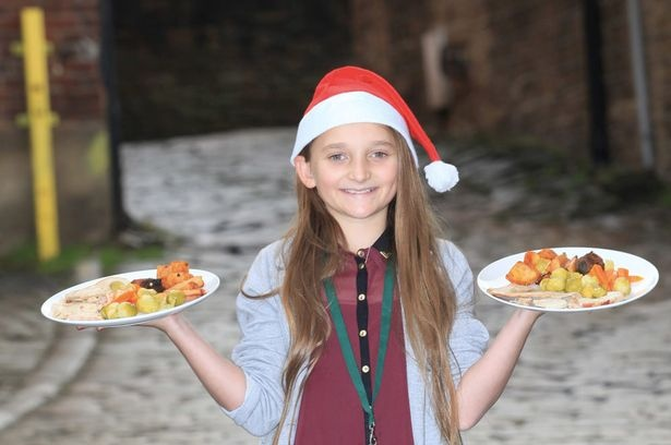 Gracie McNulty serves Christmas dinner to 50 homeless people in Dewsbury to fulfil her dead dad's wish who worked at Kirklees Markets for over 10 years.