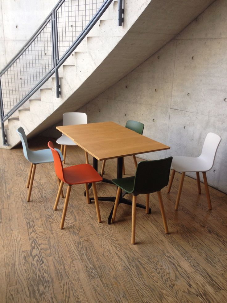 Vitra Hal chairs in Tadao Andos conference centre at the vitra campus (http://www.cimmermann.co.uk/product/vitra_hal_light_wood_dining_chair/)