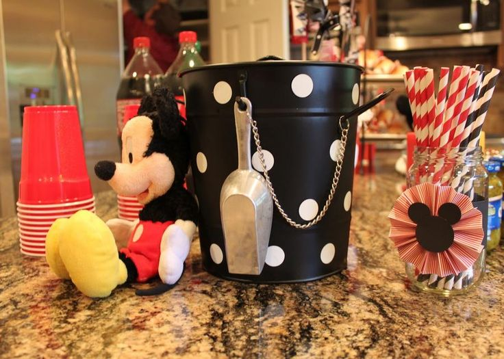 Mickey Mouse birthday party drink station.