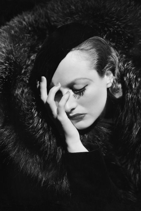 BAZAAR takes a look back at actress Joan Crawford's most hollywood-glam moments. See them all: