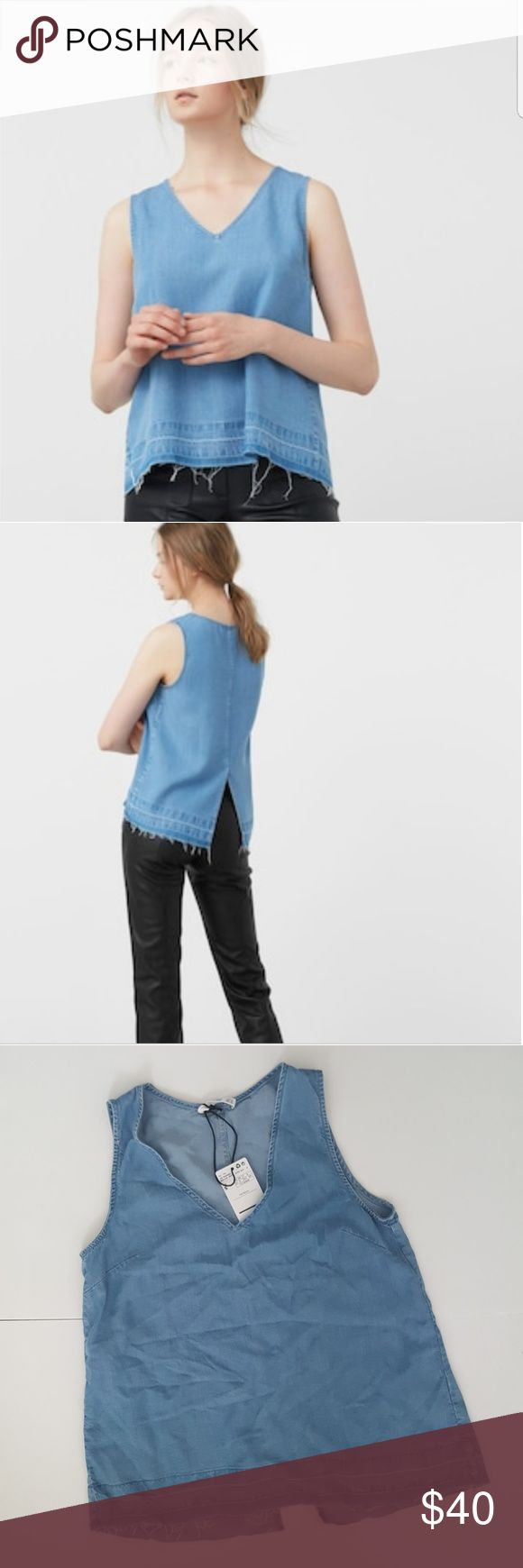 "Mango Chambray Denim Megan Top Lightweight sleeveless top with V neckline, raw hem, and vented back. Bust 17""  Length approximately 23 1/2"" 100% lyocell Mango Tops"