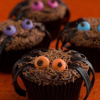 Spider cupcakes: a devilishly delicious treat for Halloween. Turn these chocolate cup cakes into spooky spiders with liquorice legs.