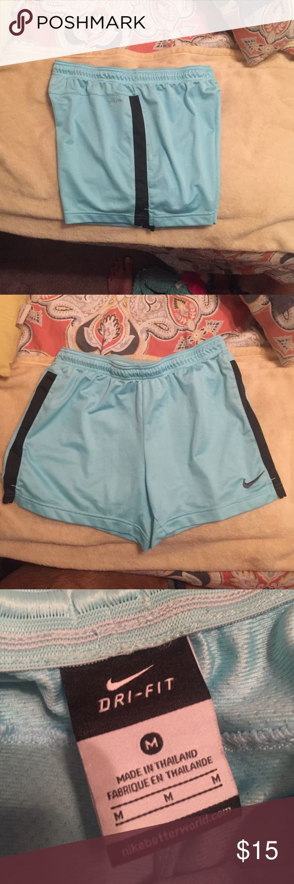 Nike shorts Womens Nike shorts! They are baby blue and black :) never worn! Nike Shorts