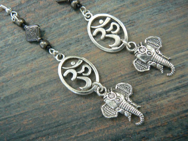 sacred elephant earrings ohm earrings spiritual earrings yoga  ohm om buddha new age boho tribal beach hipster style by gildedingypsy on Etsy https://www.etsy.com/listing/236977483/sacred-elephant-earrings-ohm-earrings