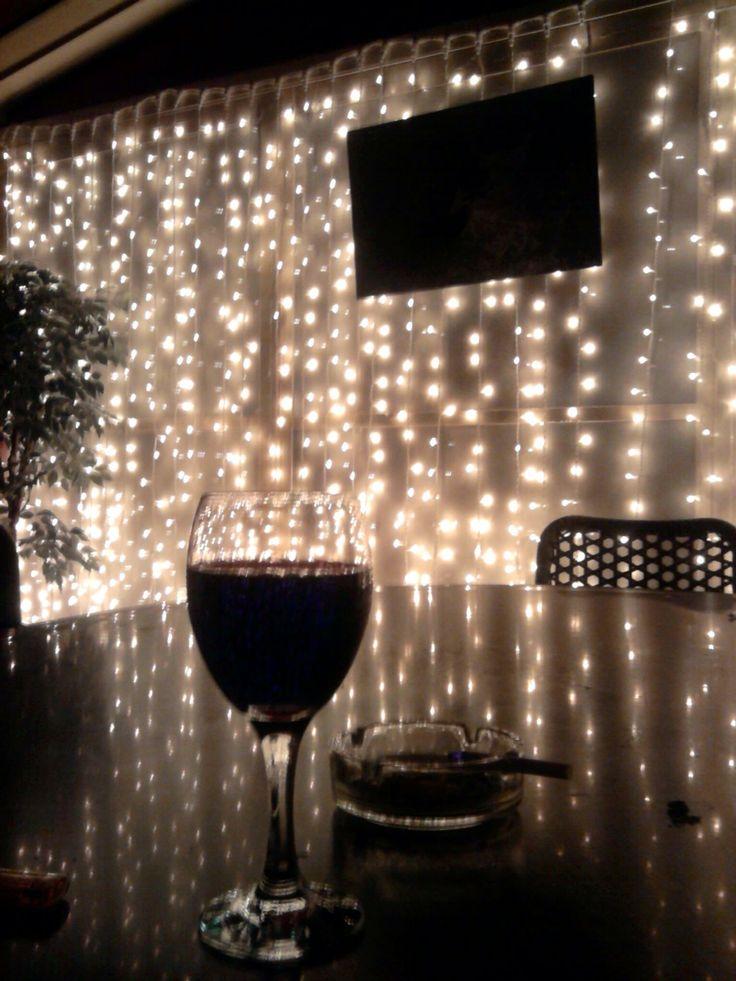 Cigarette, glass of red and lights lights lights!