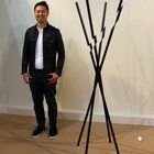 TaeWoo Kim designed and manufactured a Modified coat hanger made of plastic with an inner steel structure that looks as if a blade has sliced through it.