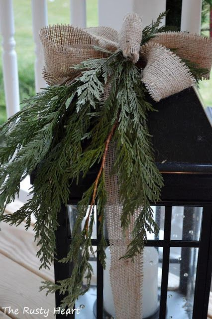 Christmas lantern so pretty with burlap bow and sprig of evergreen. From The Rusty Heart