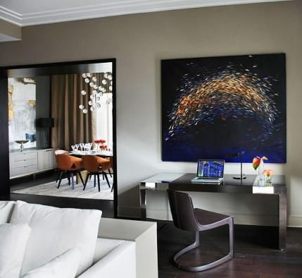 Ritz-Carlton Showcase Apartment by Doug Atherley   Traditional Home Orange hues in the painting Leaping Midnight Shoal by Nicola Bealing segue into the dining room with its handsome orange chairs.