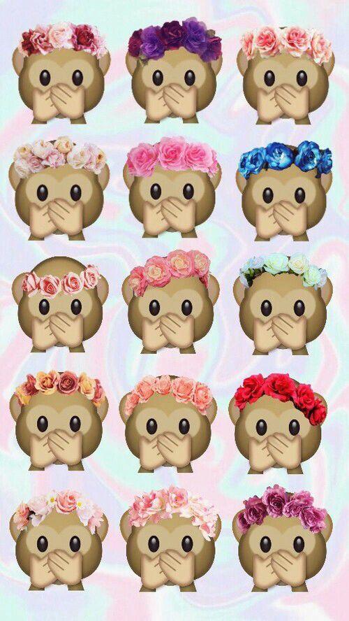 Scimmie che si tappano la bocca con delle rose in testa