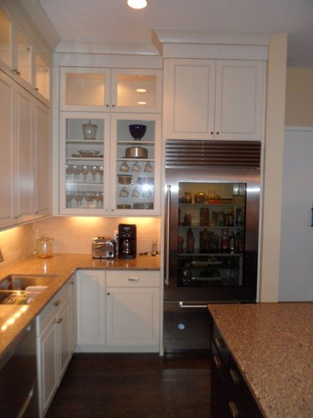 new york city kitchen with stacked glass cabinets - Kitchen Cabinets New York City