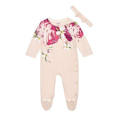 This sleepsuit is from the Baker by Ted Baker childrenswear range, offering excellent comfort for a little one's nightwear collection. Made from pure cotton, its popper fastening design is finished in light pink with a bold floral print while a rip tape fastening headband features a pretty bow applique.