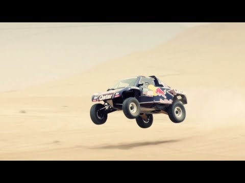 Just days before the start of the 2013 Dakar Rally, the Qatar Red Bull Rally Team took a trip to the Peruvian desert to finalize their preparations for the race. Carlos Sainz and Nasser Al-Attiyah talk about their expectations for this year's Dakar.    http://redbull.com  ___________________________________________________________    Experience the w...