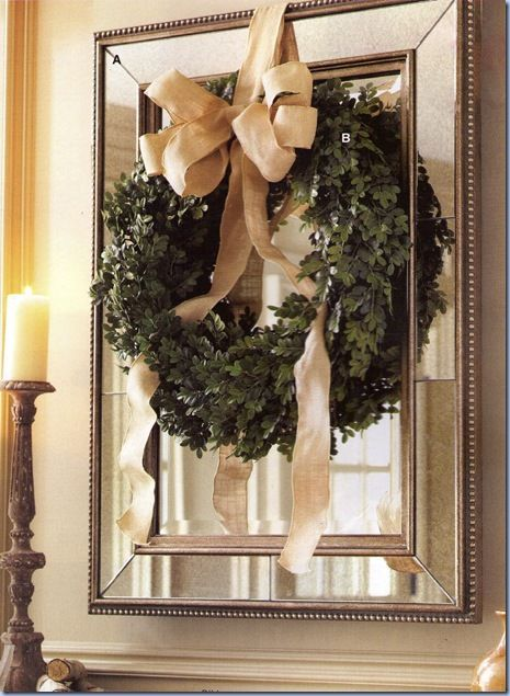 I am going to hang a wreath in my hall way this year! So pretty against the mirror!