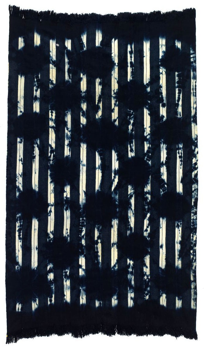 Africa | Woman's Shawl from the Dioula People, Ivory Coast | 20th century | 12 strips of hand spun cotton, resist dyed with indigo  A single glass bead is woven into the bottom right side corner