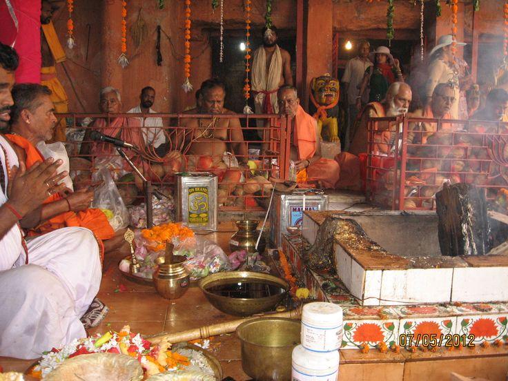 Yajna (sacred fire sacrifice) in front of Mother Durga, presided by Pundit Amareswar Mishra and managed by disciples and devotees of Baba Buddhanath Das, Khandagiri, Bhubaneswar, Odisha, India
