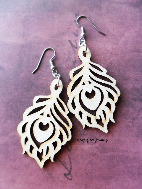 Natural peacock wooden earrings.