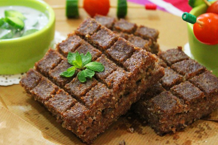 kibbeh bil sanyeh aka flat kibbeh baked in the oven, others call it sandwich kibbeh where ground meat and pine nuts are pressed between two layers of very fine minced beef with bulgur. One of the m…