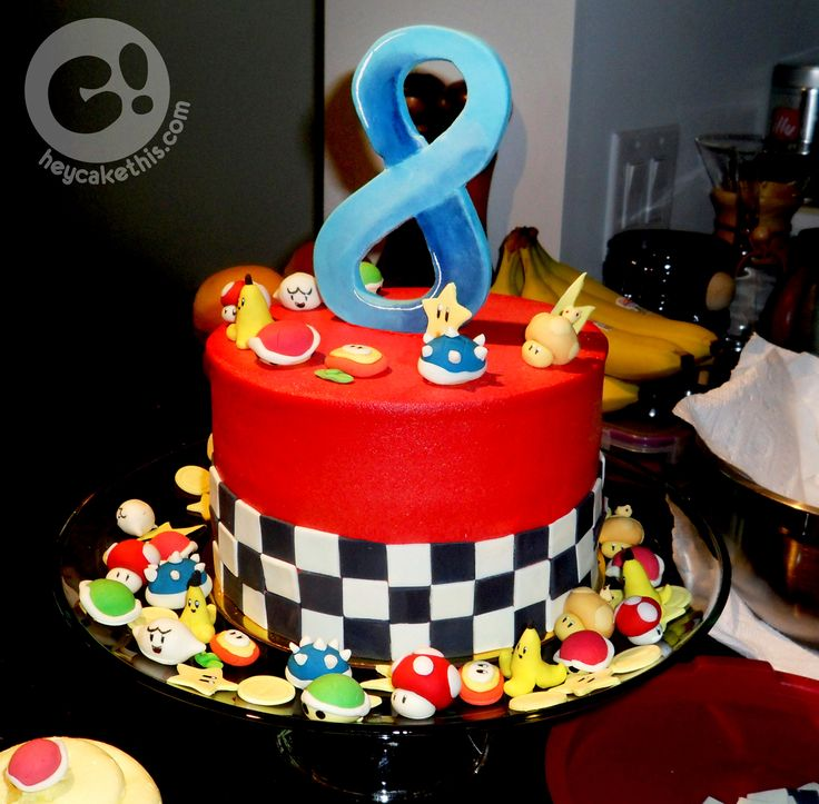 Mario Kart themed cake made for a launch party celebrating Mario Kart 8! Complete with edible Mario Kart item toppers!