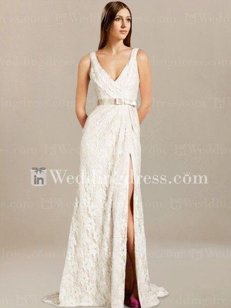 Lace wedding dress with on trend crisscross V neckline is elegant.