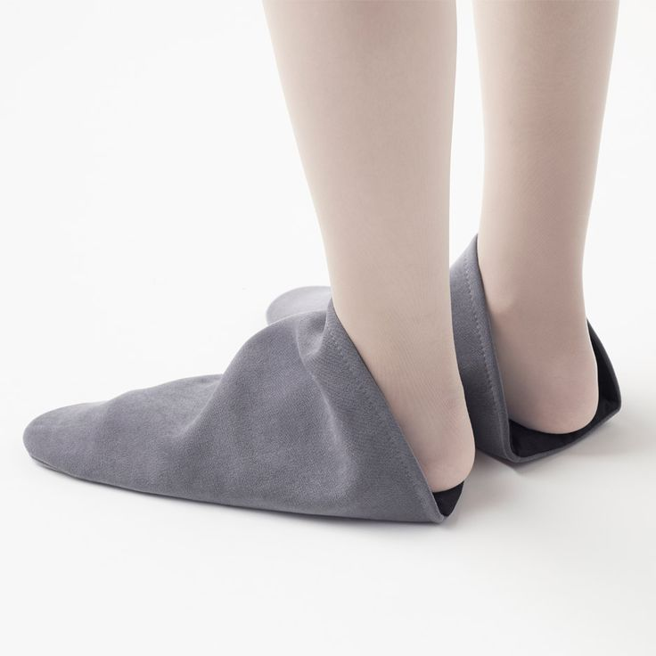 These triangular slippers by Nendo lack traditional fastenings and instead feature a simple circular opening for the wearer's foot.